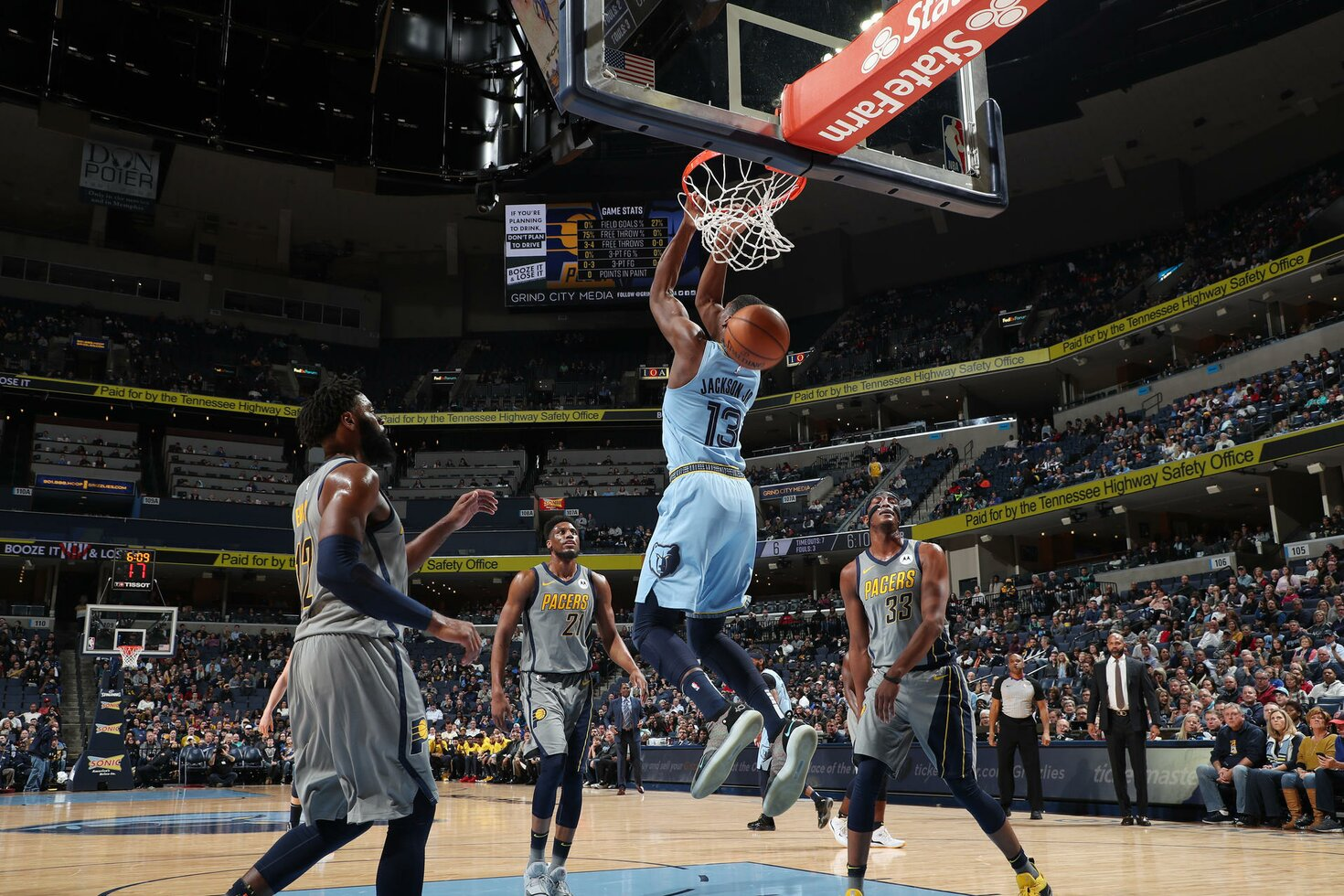 MEMPHIS, TN - JANUARY 26:  Jaren Jackson Jr. #13 of the Memphis Grizzlies backwards dunks against the Indiana Pacers on January 26, 2019 at FedExForum in Memphis, Tennessee.