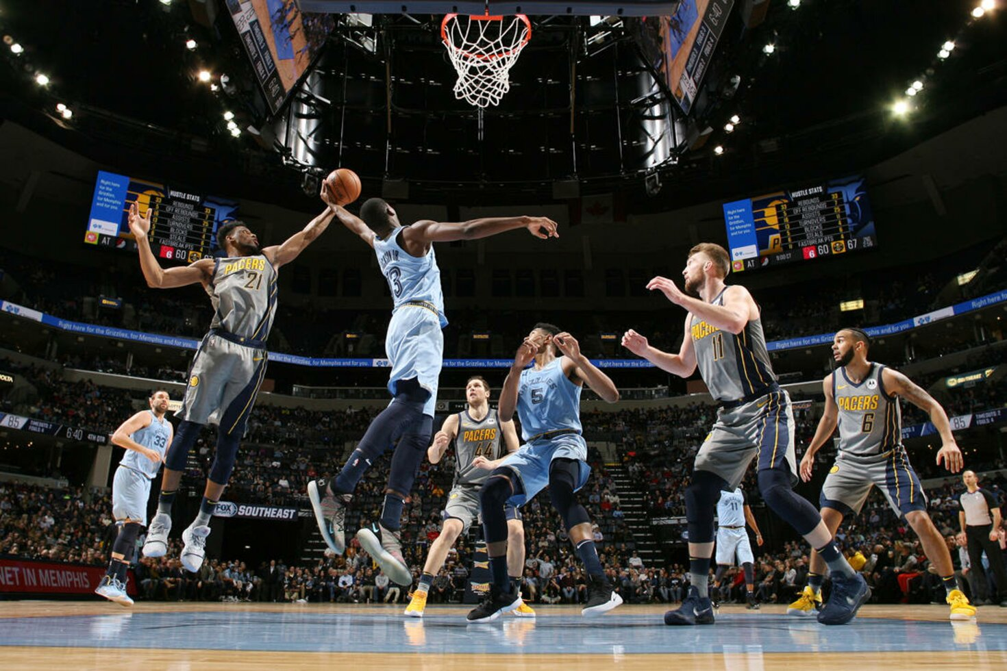 MEMPHIS, TN - JANUARY 26: Jaren Jackson Jr. #13 of the Memphis Grizzlies blocks the shot against Thaddeus Young #21 of the Indiana Pacers   on January 26, 2019 at FedExForum in Memphis, Tennessee.